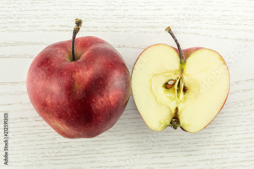 Photo  Red delicious one apple and section half flatlay on grey wood background
