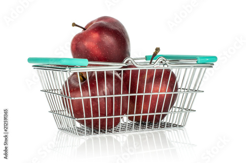 Photo  Three apples red delicious in a shopping basket isolated on white background