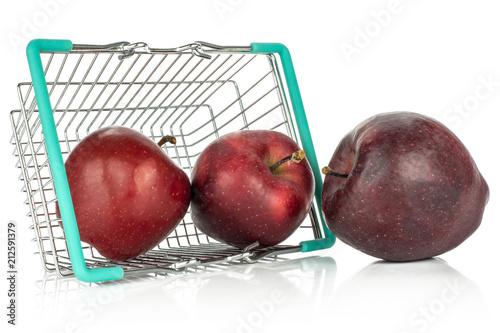 Photo  Three apples red delicious out a shopping basket isolated on white background