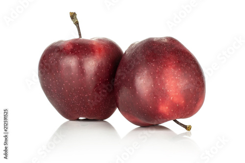 Photo  Two red delicious apples isolated on white background.