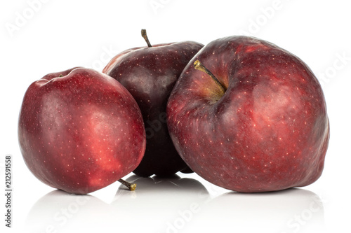 Photo  Three red delicious apples deep red isolated on white background.