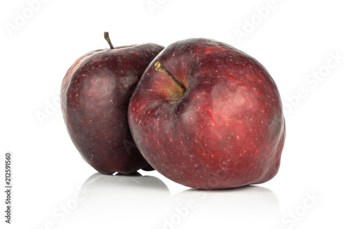 Photo  Two red delicious apples deep red isolated on white background.