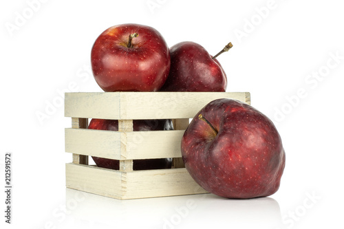 Photo  Apples red delicious in a wooden box and one is near isolated on white background