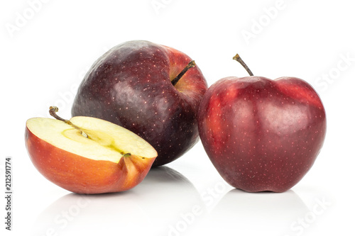 Photo  Red delicious two apples and a half isolated on white background.