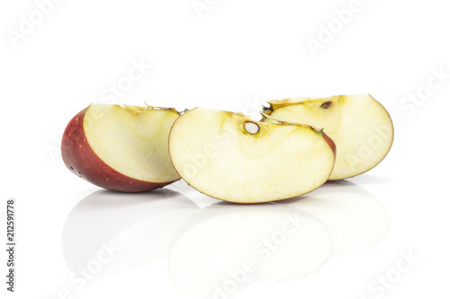 Photo  Red delicious three apple slices isolated on white background.