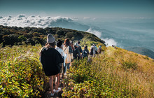 Group Of People Walking On Mountain In Morning Sunrise, Trekking On The Kew Mae Parn,Inthanon National Park Mountain