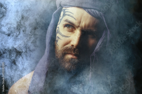 tattoo on the face,  male portrait in the form of an assassin, cosplay,  tattooe Poster