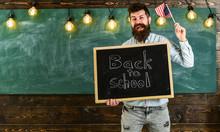 Teacher Holds Blackboard With ...
