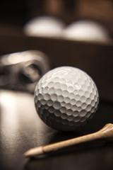 Closeup golf ball on the dark background