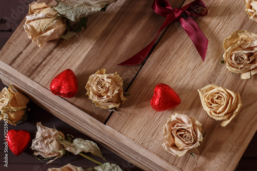 Fotografie, Obraz  gift in a wooden box with roses and chocolates