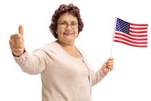 Elderly Woman Holding An American Flag And Making A Thumb Up Sign