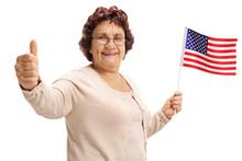Elderly Woman Holding An Ameri...