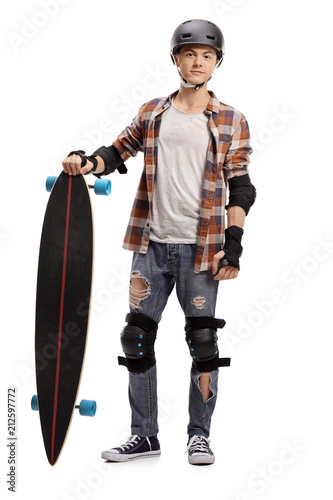 Teenage skater with a longboard and protective equipment
