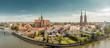 Leinwanddruck Bild Poland. Wroclaw. Ostrow Tumski, park, and Odra River. Aerial 4K video.