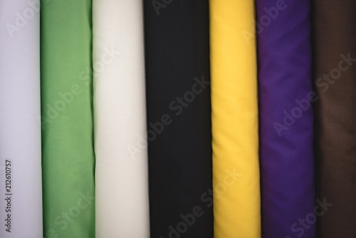 Deurstickers Stof Various color fabric arranged in row