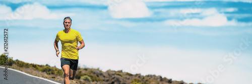 Runner man running on triathlon marathon race outdoors in summer heat. Male athlete training cardio running long distance outside. Banner panorama.