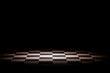 Abstract Chessboard On Dark Background Lighted With Snoot