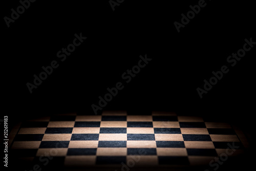 Fotografija abstract chessboard on dark background lighted with snoot