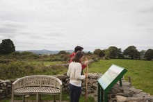 Couple Looking At Painting While Standing Outdoors