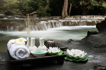 Beautiful composition of spa accessories on waterfall background.