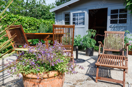 Cabanon avec terrasse et salon de jardin - Buy this stock photo and ...