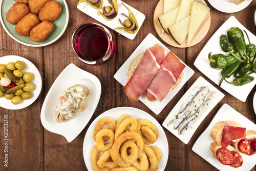 Spanish food. Overhead closeup photo of various tapas with wine, with copy space