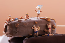 Miniature People In Swimsuit On An Ice Cream Bar
