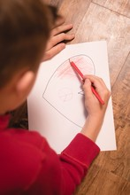 Boy Drawing On Craft Paper