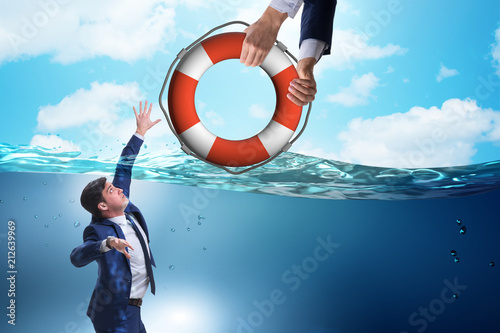 Businessman being saved from drowning Slika na platnu
