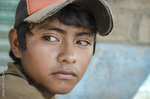 Fototapeta Latin American teen Great glance portrait from a young boy in the southern borde