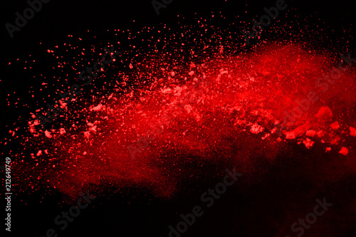Valokuva  Abstract red powder splatted background,Freeze motion of color powder exploding color powder