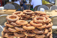 Pile Of Simits (turkish Bagels) On Street During Daytime.