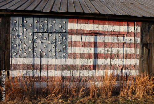 Fototapeta American flag painted on side of old Southern Maryland tobacco barn and dedicate