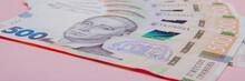 Modern Ukrainian Money On Pink...