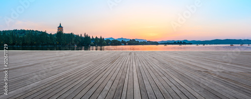 Empty wooden floor and hill silhouette in Hangzhou