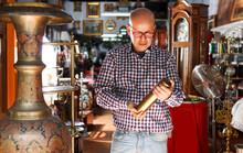Man Visiting Shop Of Antique Goods