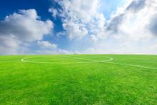 Green Football Field Under Blu...
