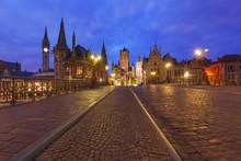 Picturesque Medieval Building And St. Michael's Bridge At Night In Ghent, Belgium