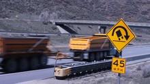 Trucks Rolling Down The Highwa...