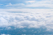 Leinwandbild Motiv Big Blue sky and Cloud and city under cloud Top view from airplane window,Nature background.