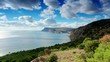 4K. Cloudy sky over the mountains and the sea. Balaklava, Crimea, Russia.
