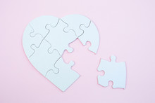 White Heart Puzzle With A Missing Piece