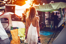 Beautiful Young Woman Walking On Festival Camping Tents For Sunset Dancig Party
