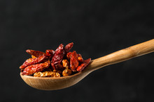 Dried Chili Peppers Seasoning In A Wooden Spoon