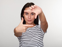 Young Woman Taking Picture With Imaginary Camera