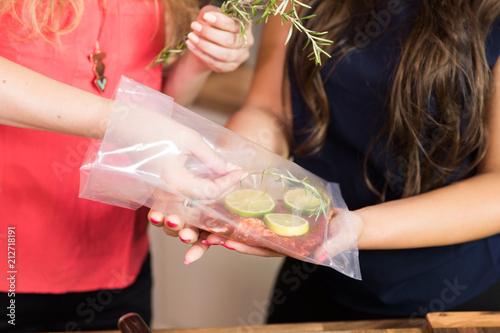 Fotografija  Unrecognizable women cooking sous vide.