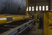 Welder Repairing Vessel Parts In Factory