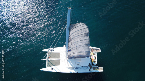 Aerial drone bird's eye view photo from luxury Catamaran docked at tropical deep Canvas Print