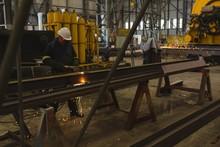 Welder Repairing Metal Frame