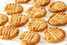 Delicious Homemade Peanut Butter Cookies On Cooling Rack. White Wooden Background. Healthy Snack Concept.